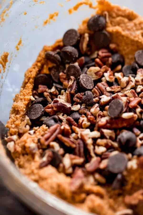 A close up view of paleo pumpkin bread batter with chocolate chips and pecans ready to be stirred in.