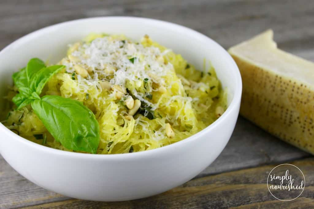 Spaghetti Squash with Garlic and Herbs   Tender strands of roasted spaghetti squash are tossed with olive oil, fresh herbs and toasted pine nuts for a simple yet satisfying dish.   whole30 recipes   gluten-free dinners   dairy-free dinners   vegan dinners    The Real Food Dietitians #whole30dinner #spaghettisquash