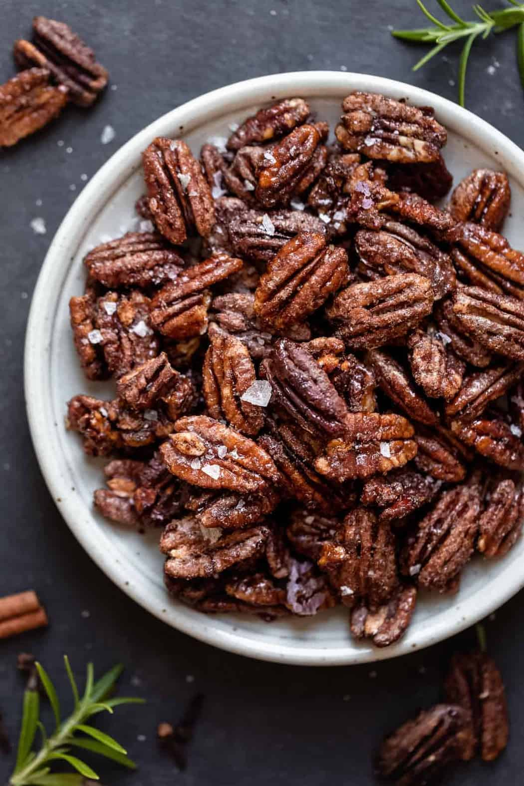 Overhead view of Holiday Spiced Pecans on a white plate.