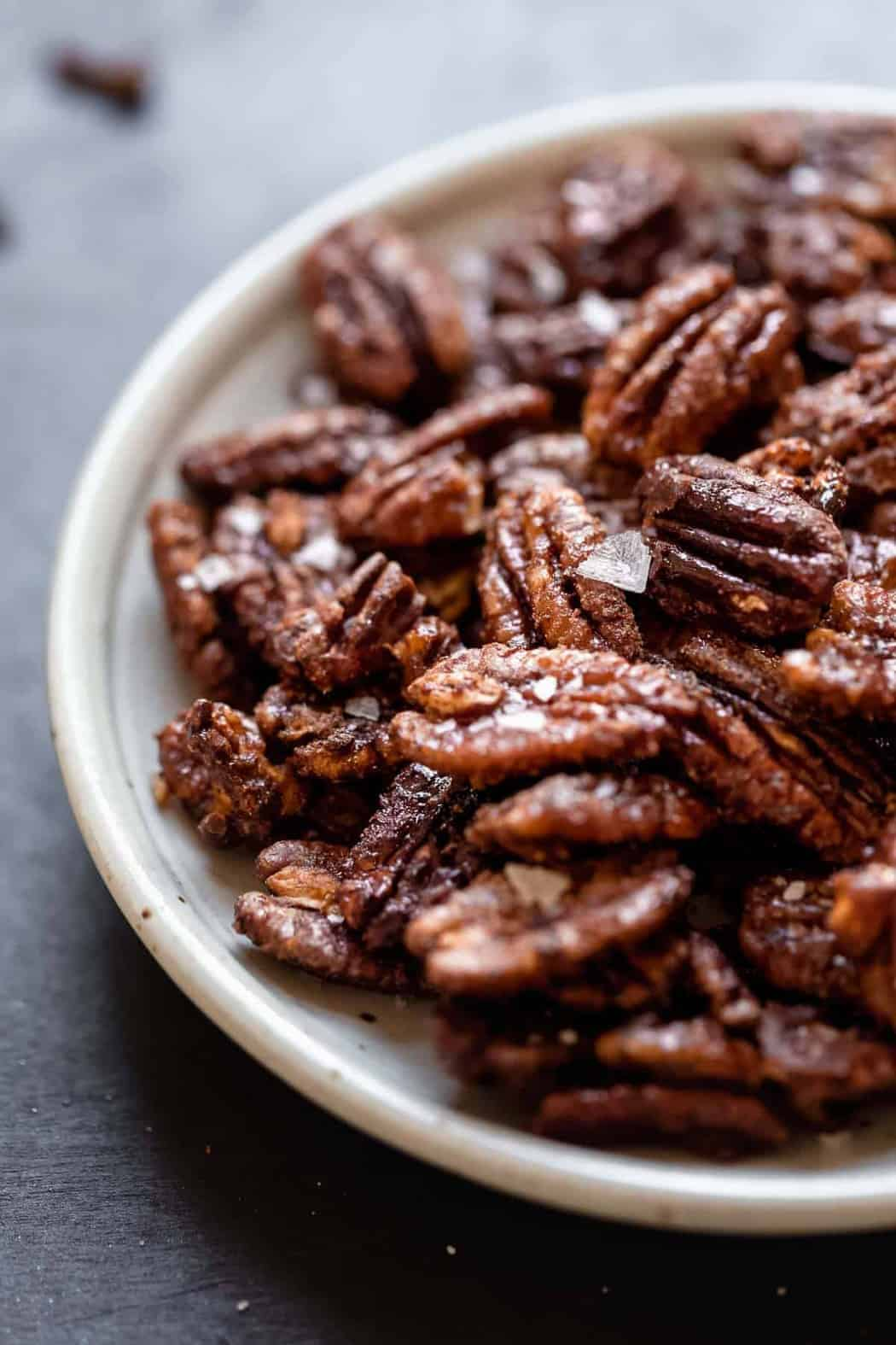 Holiday Spiced Pecans on a white plate