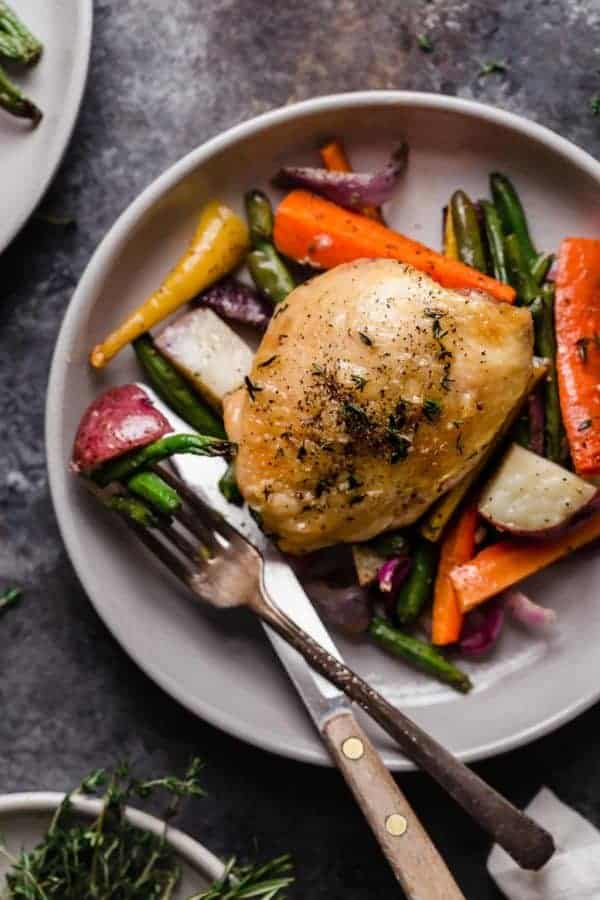 Overhead shot of One-Pan Roasted Chicken and Vegetables on a white plate.