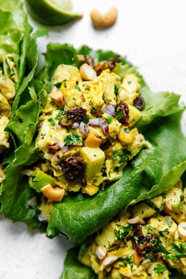 Curry chicken salad in two lettuce wraps ready for serving