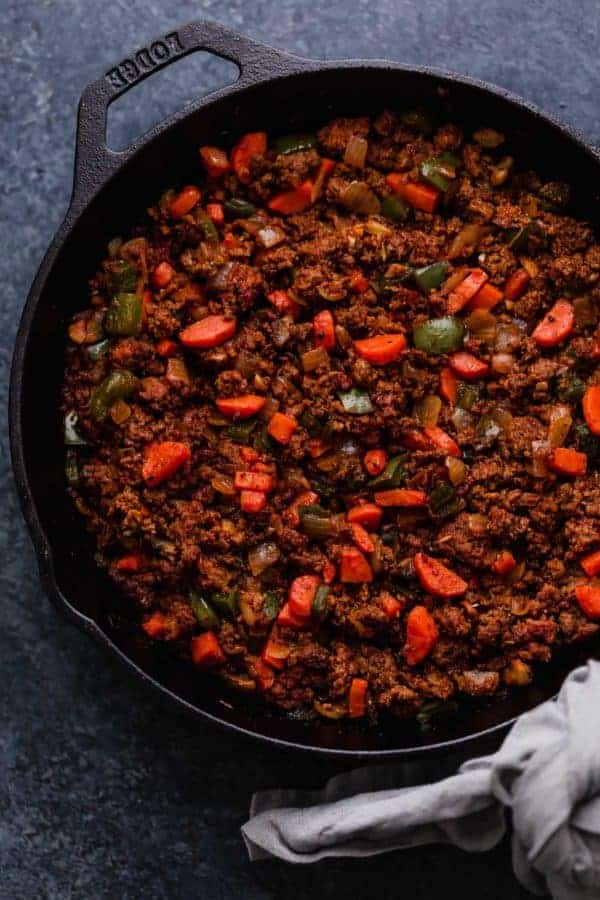 Photo of Shepherd's Pie filling in a cast iron dish.