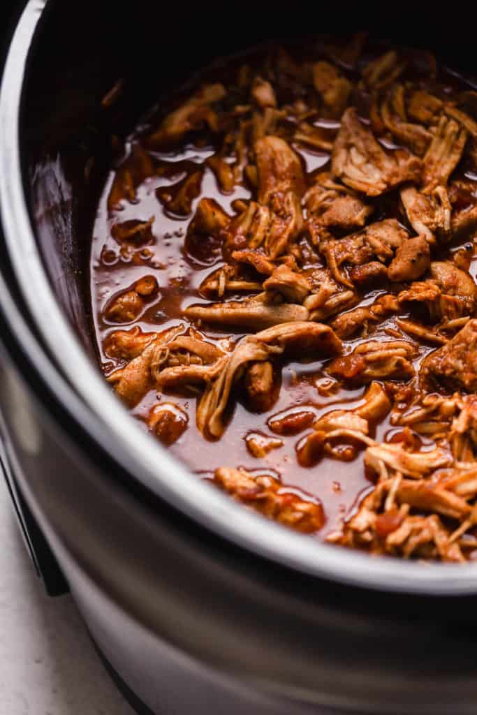 Shredded chicken taco meat in a slow cooker