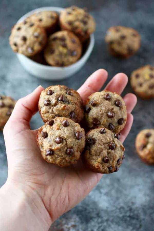 Grain-Free Banana Chocolate Chip Mini Muffins with four muffins resting in a person's hand