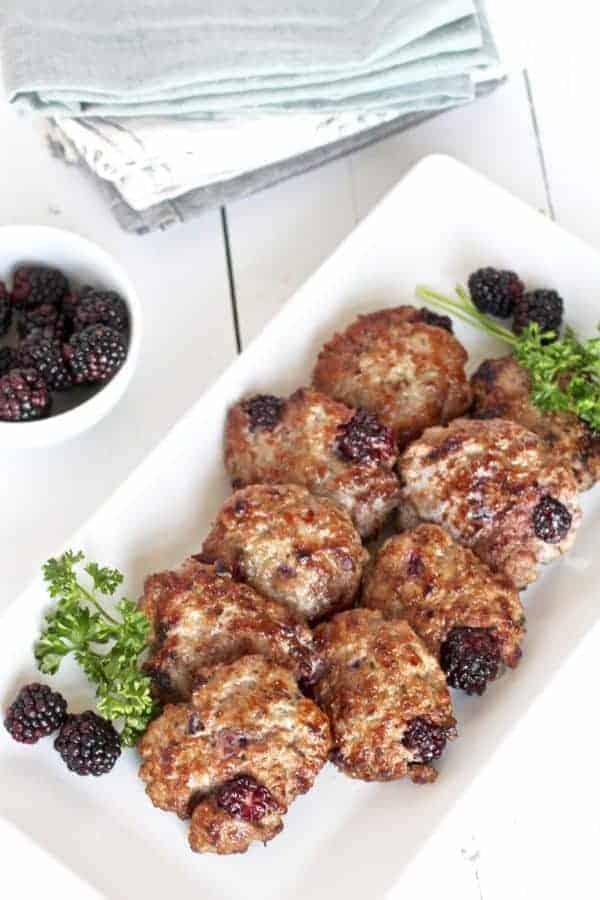 blackberry sage breakfast sausage on a white serving platter