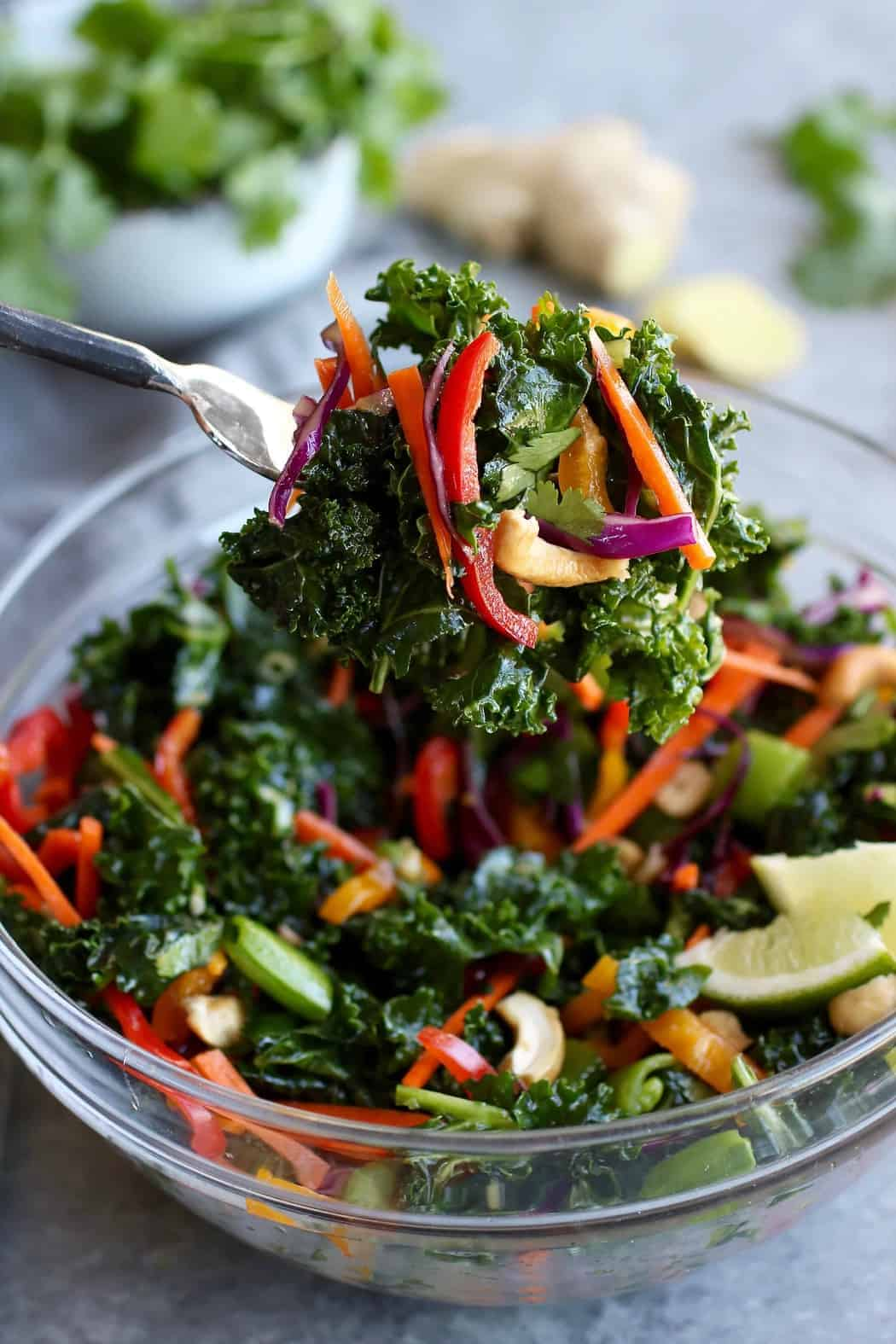 Thai Kale Salad with Cashews on a fork