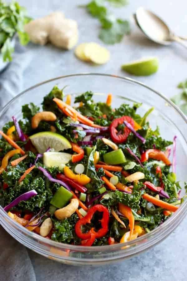 Thai Kale Salad with Cashews in a glass bowl