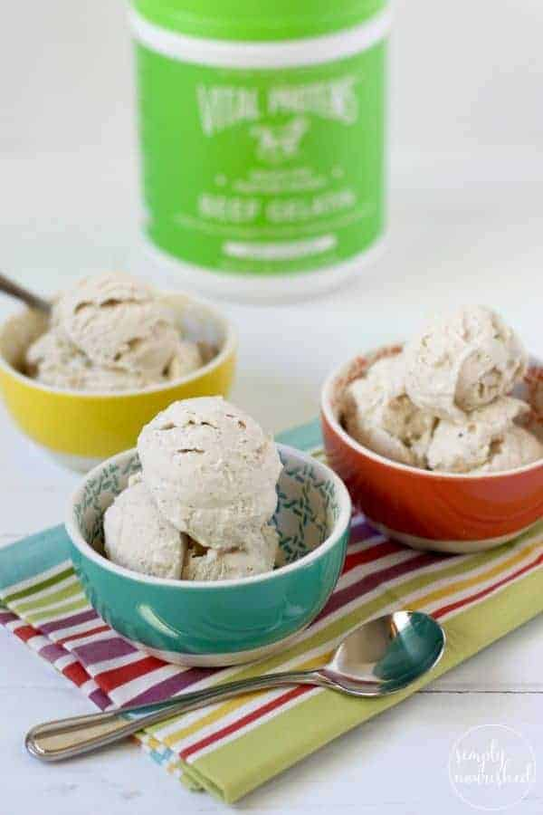 Dairy-free Vanilla Bean Ice Cream in colored bowls on a striped towel