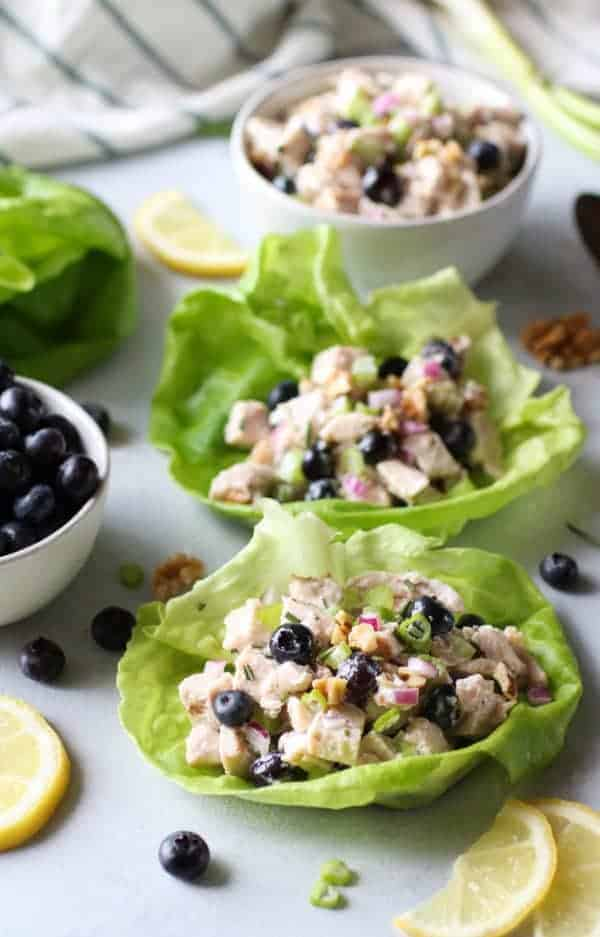 Blueberry Chicken Salad and Rosemary in lettuce bowls on a table