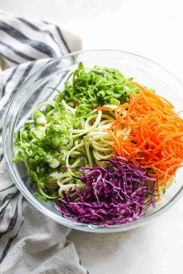 Spicy Asian Zucchini Noodles ingredients in a glass bowl