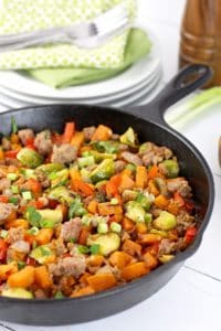Thirty Egg-free Whole30 Breakfasts Brussel sprouts, sweet potato, and sausage hash in a skillet