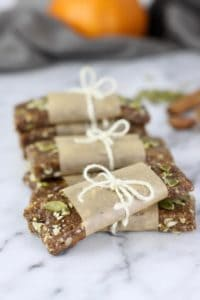Pumpkin Spice Protein Bars wrapped in paper and tied with a string bow on a counter