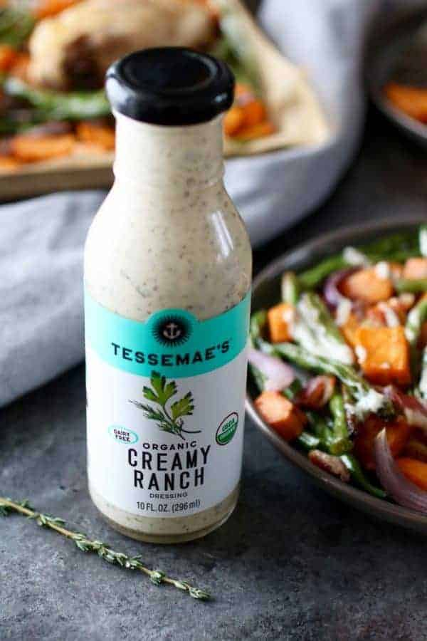 Chicken Bacon Ranch Sweet Potato Bake with Tessemae's Organic Creamy Ranch dressing in a bottle on the side