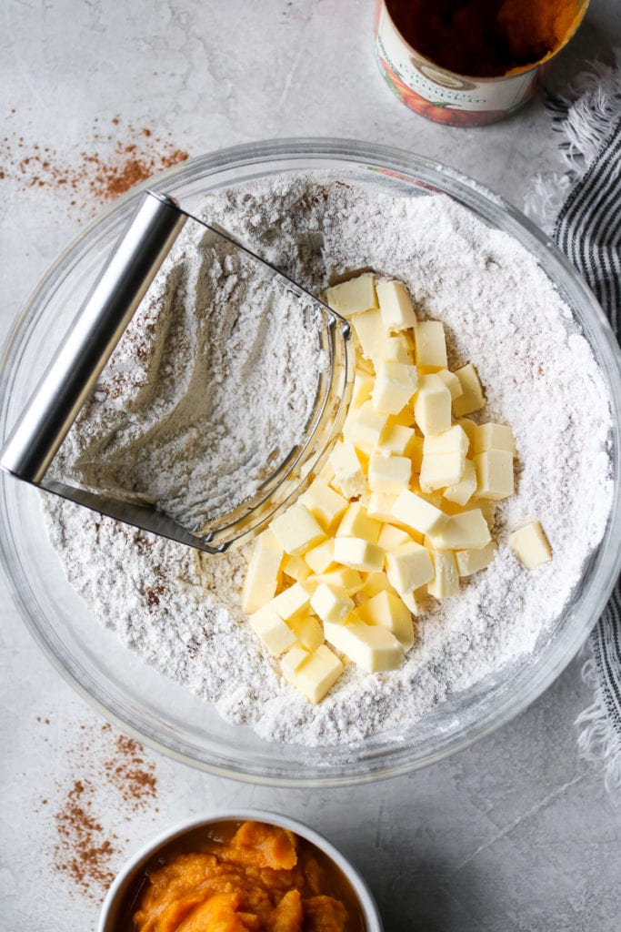 Cold butter bring cut into flour using a pastry cutter