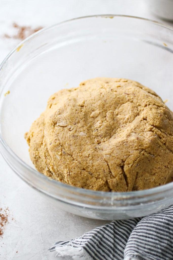 Gluten free pumpkin cookie dough in a clear glass bowl