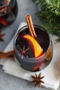 Overhead view of slow cooker mulled wine in a glass tumblar