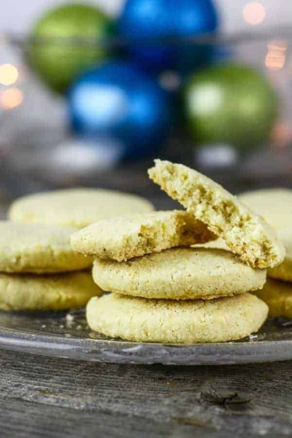 Gluten-Free Lemon-Shortbread Cookies on a glass plate with one broke in half