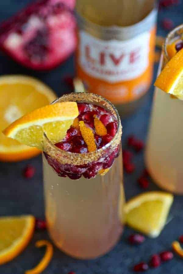 This Pomegranate Kombucha Mimosa recipe is a twist off of the traditional champagne and OJ combo with the addition of flavor bursting pomegranate seeds and probiotic rich LIVE Kombucha. | Paleo mimosa recipe | Vegan mimosa recipe | dairy-free mimosa recipe | healthy mimosa recipe | paleo drink recipes | vegan drink recipes | dairy-free drink recipes || The Real Food Dietitians #mimosas #paleodrinks #vegandrinks #healthymimosa