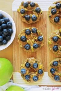 Thirty Egg-free Whole30 Breakfasts Blueberry Pistachio Apple Sandwiches on a wooden cutting board