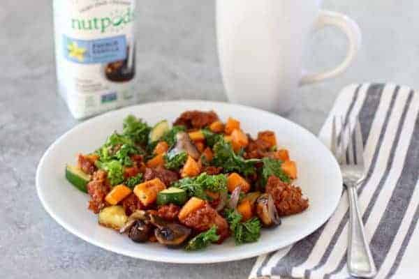 Egg free veggies and sweet potato hash on a white plate