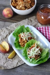 Get the flavor of a summertime barbecue from your slow cooker with this easy Slow Cooker Peach BBQ Chicken   Whole30 chicken recipes   Paleo chicken recipes   Grain-free chicken recipes   Gluten-free chicken recipes   Dairy-free chicken recipes   Whole30 slow cooker recipes   whole30 dinner recipes    The Real Food Dietitians #whole30dinner #healthyslowcooker #easydinners