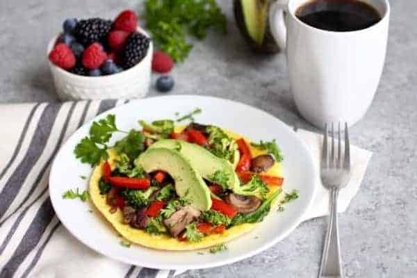 Open faced veggie omelet with a side of berries