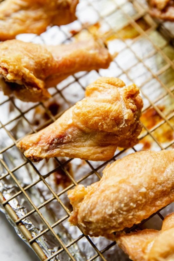 Perfectly brown and crispy baked wings on a baking rack over a baking sheet