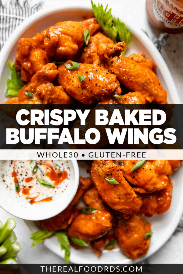 Crispy baked Buffalo wings piled high on a white platter coated in homemade Buffalo sauce