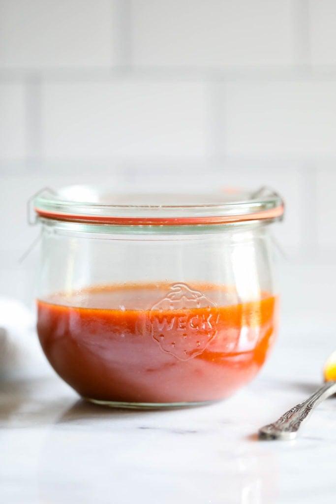 Homemade buffalo sauce in a Weck jar