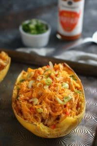 Buffalo Chicken Stuffed Spaghetti Squash on a table