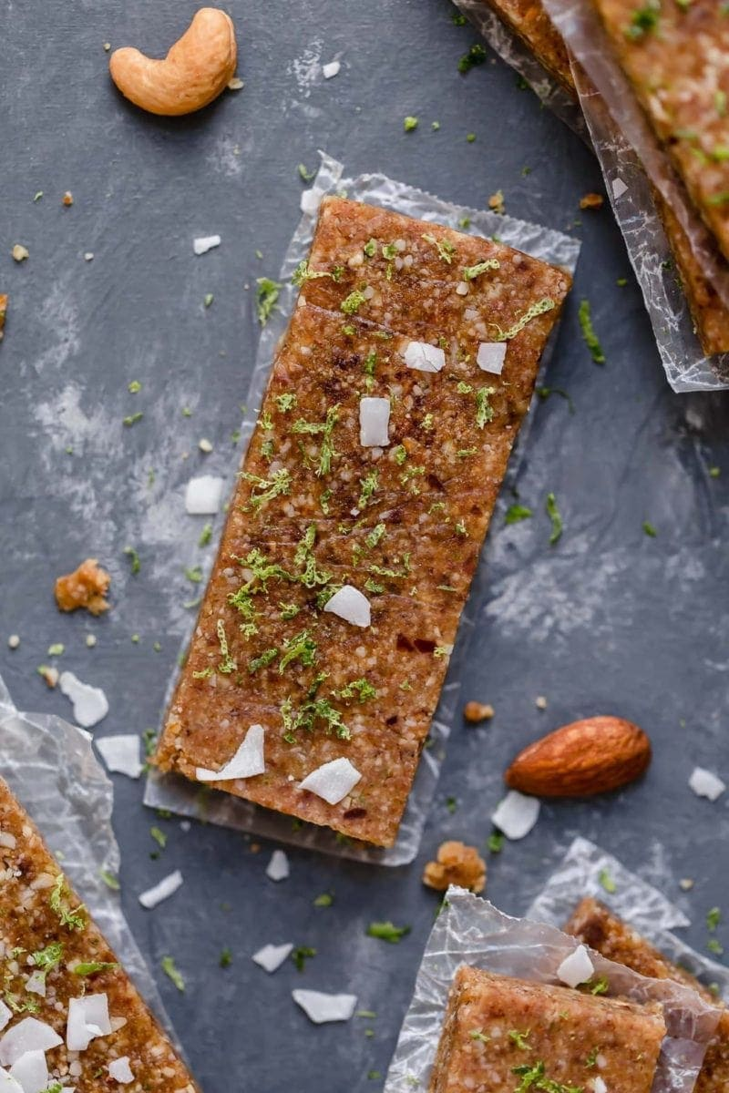 Overhead shot of Key Lime Energy Bars topped with grated lime zest and coconut shreds.