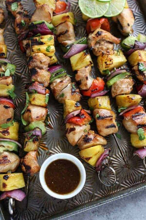 Teriyaki Chicken and Pineapple Kebabs on a cooking sheet