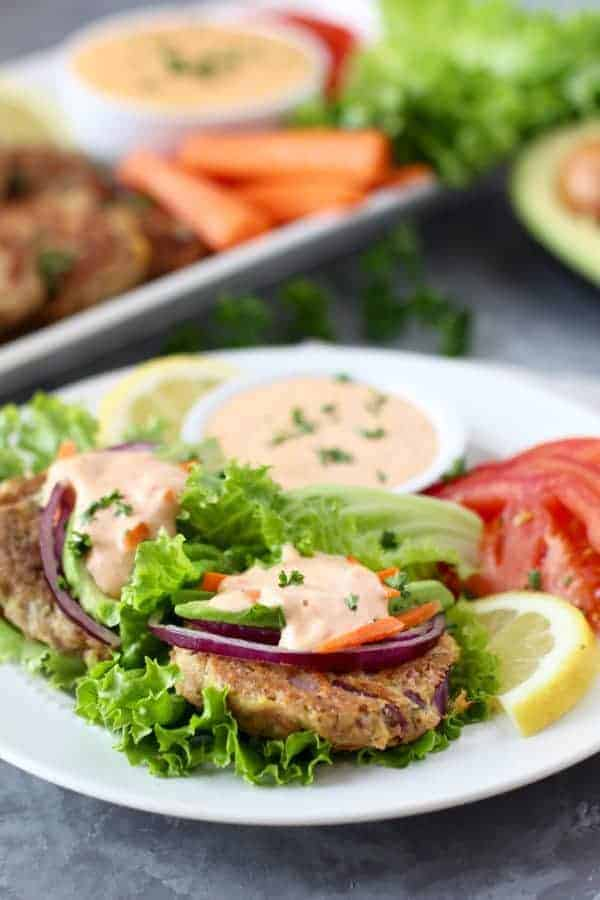 Easy Tuna Cake Lettuce Wraps on a plate topped with roasted red pepper aioli.
