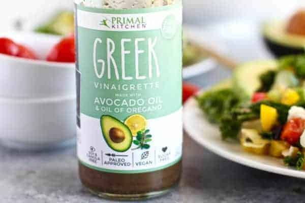 Primal Kitchen Greek Vinaigrette | Greek Kale Salad with Avocado | The Real Food Dietitians | https://therealfoodrds.com/greek-kale-salad-avocado/