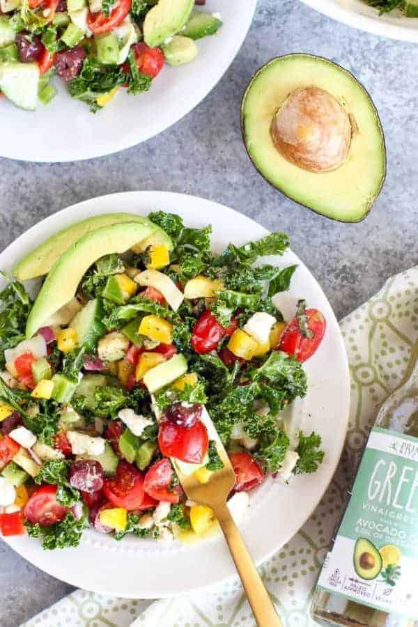 Primal Kitchen Greek Vinaigrette with Kale Salad on a white plate