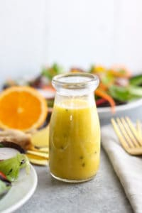 Ginger-Sesame Vinaigrette in glass bottle on gray table