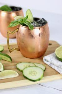 Healthy 4th of July Menu Drink : Cucumber Basil Kombucha Mule in a copper mug