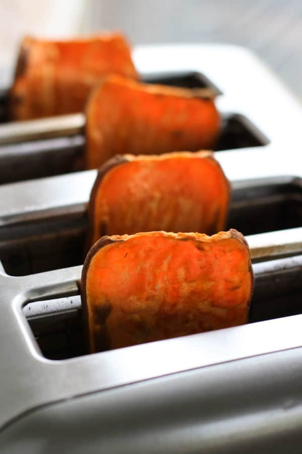 Oven Baked Sweet Potato Toast 4 Ways with slices of sweet potato popped up in a toaster