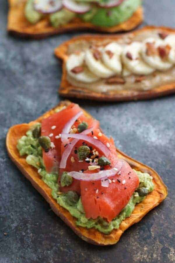 Oven Baked Sweet Potato Toast 4 Ways with avocado, tomatoes, and onion
