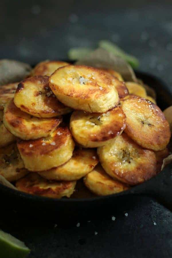 Whole30 Fried Plantains in a cast iron skillet