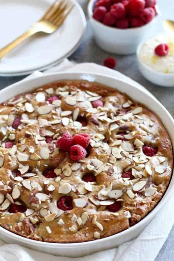 Gluten-free Raspberry Lemon Coffee Cake in a white pie dish