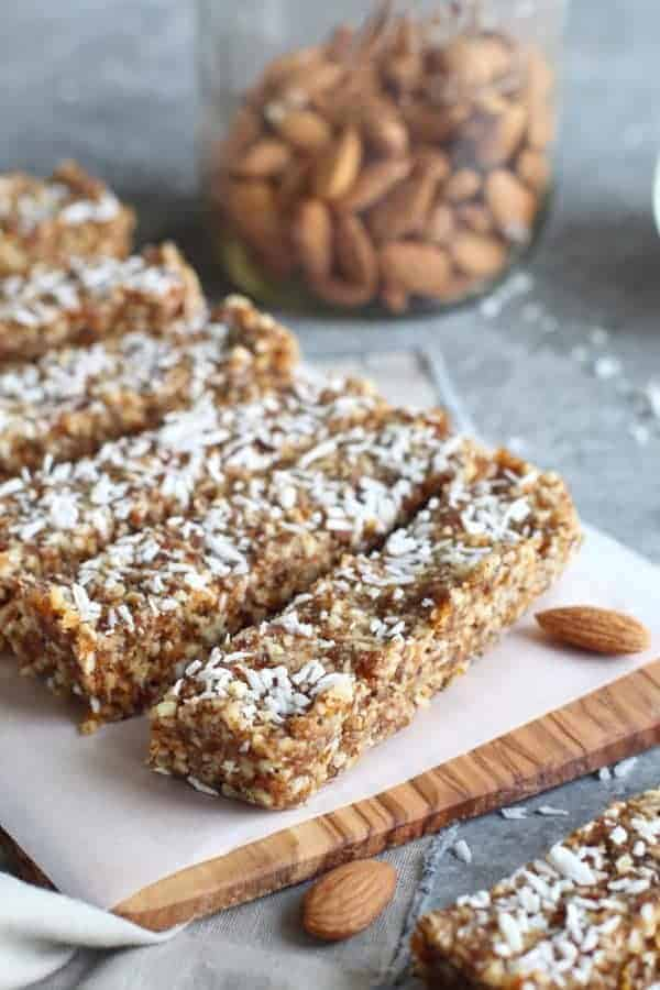 No-Bake Apricot Almond Coconut Energy Bars on a cutting board