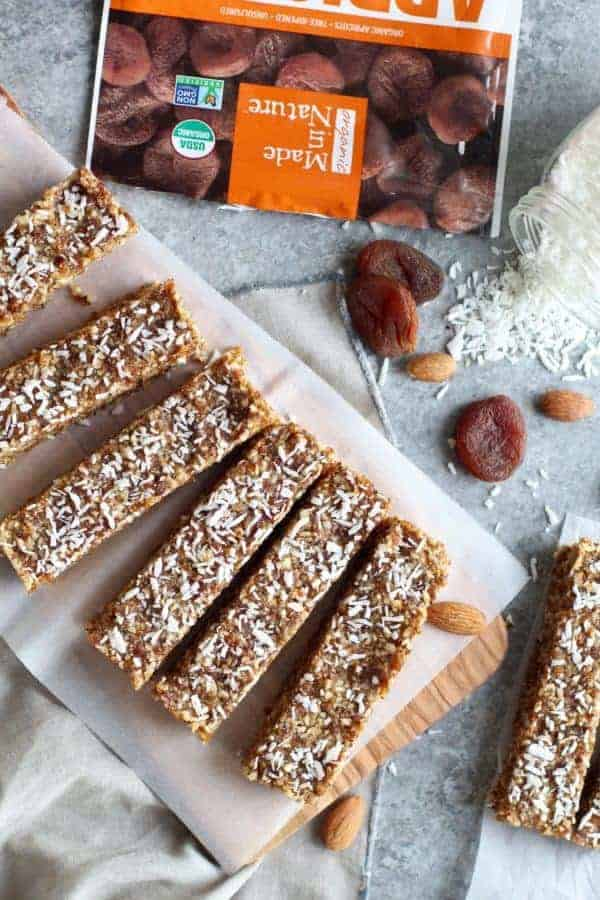 Made in Nature No-Bake Apricot Almond Coconut Energy Bars on a cutting board