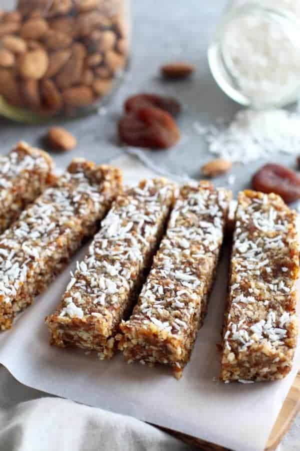 No-Bake Apricot Almond Coconut Energy Bars cut on a wooden cutting board