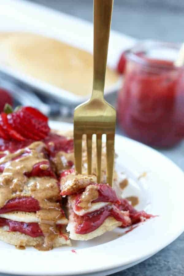 Paleo Vegan Pancakes close up with a piece on a golden fork