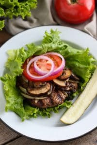 Healthy 4th of July Menu entree: Grilled Bacon Burgers on a white plate