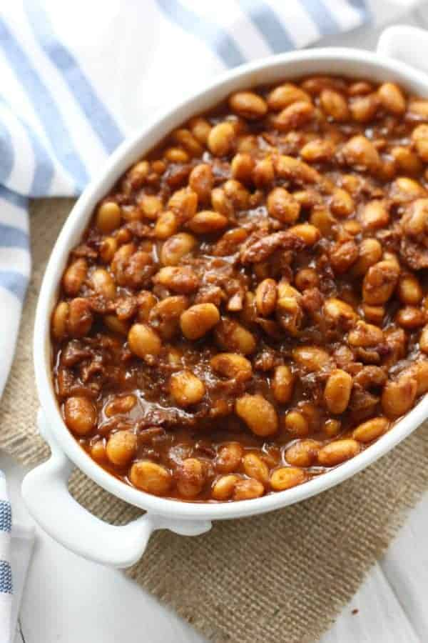 Healthy 4th of July Menu slow cooker baked beans with bacon in a white dish