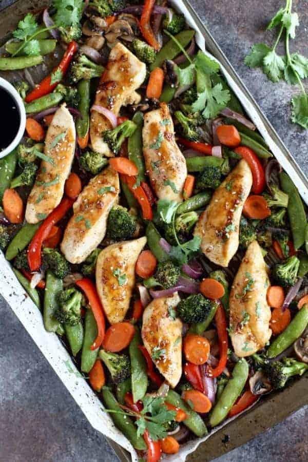 Thirty Whole30 Sheet Pan Recipes One Pan Teriyaki Chicken Veggie Bake in a sheet pan