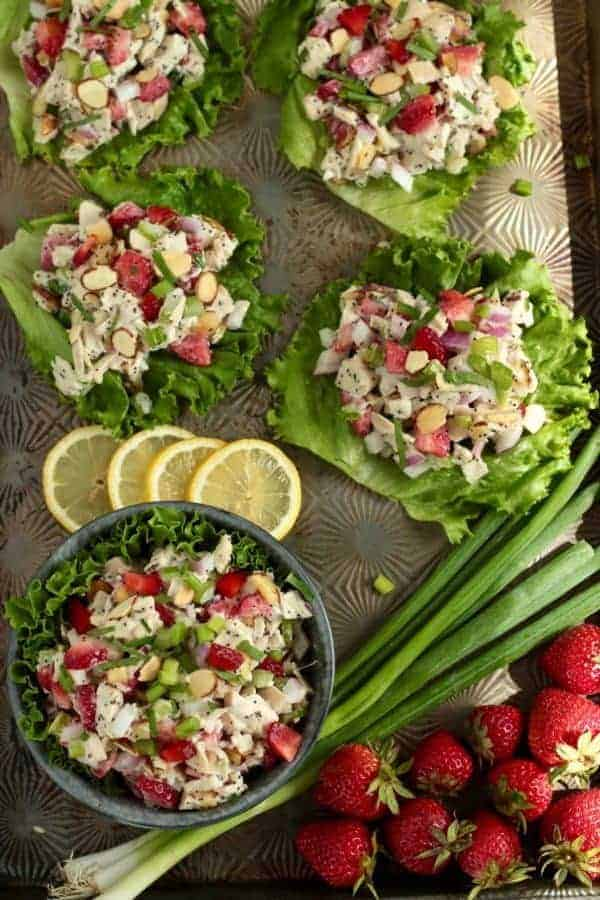 Strawberry Chicken Poppy Seed Salad with ingredients on a cookie sheet